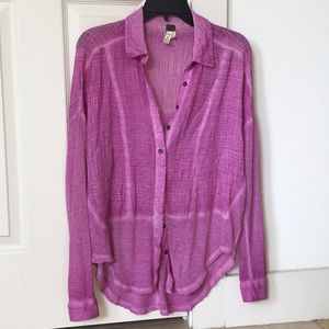 A pink long sleeve button down